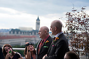 Photo by Matt Roth<br /> Assignment ID: 30148071A<br /> <br /> David Hagedorn, left, a chef and food writer, and Michael Widomski, a spokesman for the National Weather Service, walk down the aisle together on the rooftop section of  Fiola Restaurant in Washington, DC, Sunday, September 22, 2013. Justice Ruth Bader Ginsburg officiated their wedding.