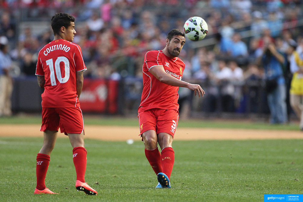 Jose Enrique, (right), and Philippe Coutinho, Liverpool, in action during the Manchester City Vs Liverpool FC Guinness International Champions Cup match at Yankee Stadium, The Bronx, New York, USA. 30th July 2014. Photo Tim Clayton