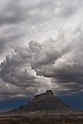 A spiral of storm clouds above Factory Butte in Southern Utah.