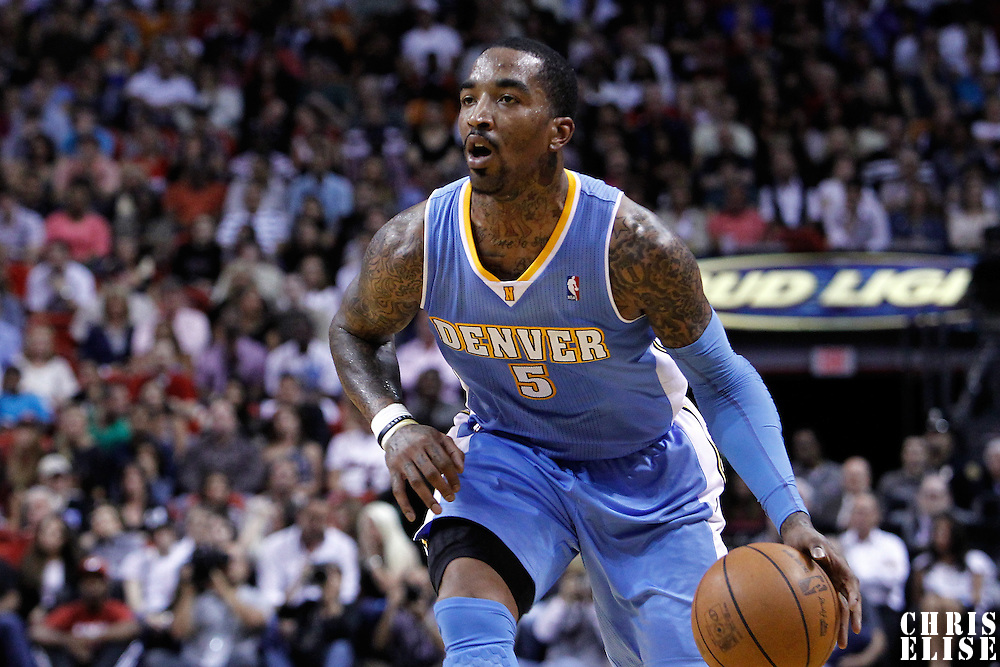 19 March 2011: Denver Nuggets shooting guard J.R. Smith (5) dribbles during the Miami Heat 103-98 victory over the Denver Nuggets at the AmericanAirlines Arena, Miami, Florida, USA.