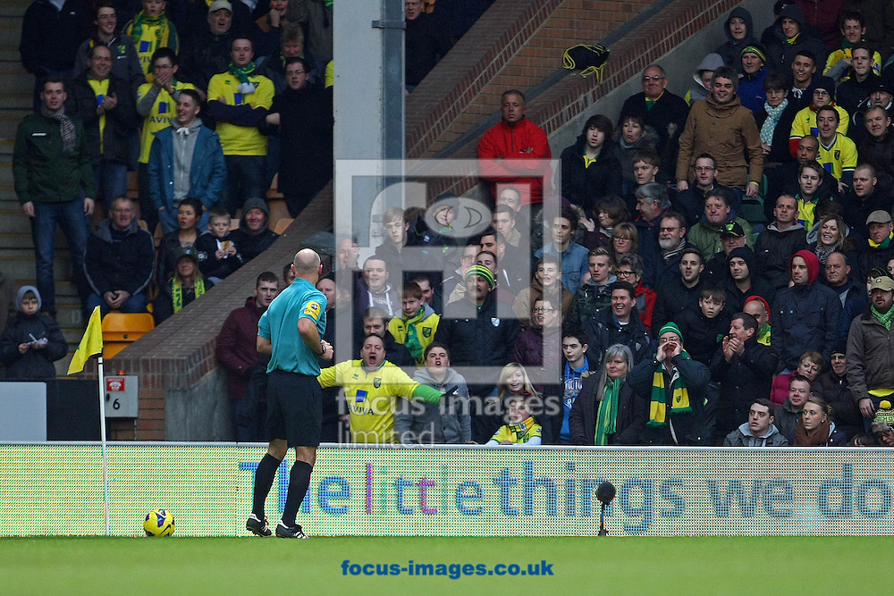 Picture by Paul Chesterton/Focus Images Ltd +44 7904 640267.09/02/2013.Referee Howard Webb is left in no doubt how the home fans feel during the Barclays Premier League match at Carrow Road, Norwich.