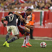 Franck Ribery, (right), Bayern Munich, is challenged by Jesus Sanchez, CD Chivas Guadalajara, during the FC Bayern Munich vs Chivas Guadalajara, friendly football match at Red Bull Arena, New Jersey, USA. 31st July 2014. Photo Tim Clayton