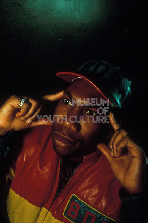 KRS One posing red and yellow leather top and matching cap, U.S.A, 1980s.