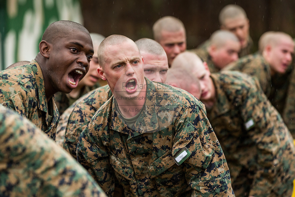 US Marine recruits respond to commands after exiting the gas chamber during bootcamp January 13, 2014 in Parris Island, SC.