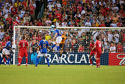 Hong Kong, China - Friday, July 27, 2007: Liverpool's goalkeeper Jose Pepe Reina punches clear from Portsmouth's David Nugent during the final of the Barclays Asia Trophy at the Hong Kong Stadium. (Photo by David Rawcliffe/Propaganda)
