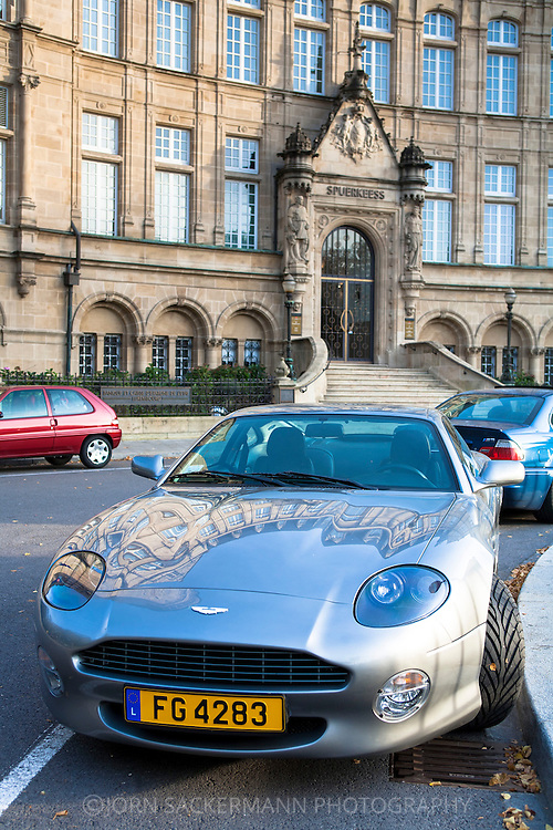 LUX, Luxembourg, city of Luxembourg, Aston Martin car in front of the National Bank/State Saving Bank at Place de Metz.<br /> <br /> LUX, Luxemburg, Stadt Luxemburg, Aston Martin vor der Staatsbank am Place de Metz.