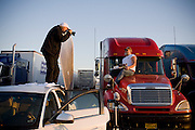 Peter Menzel, co-author of the book What I Eat: Around the World in 80 Diets, photographs truck driver Conrad Tolby at sunrise at a truckstop in Effingham, Illinois. (Conrad Tolby is featured in the book What I Eat: Around the World in 80 Diets.)  MODEL RELEASED.