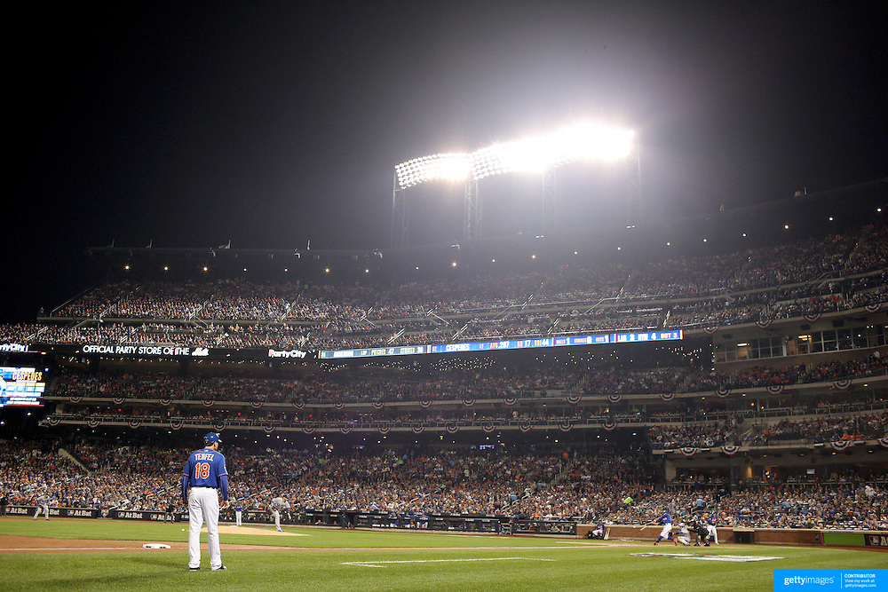 Curtis Granderson, New York Mets, hits a three run double in the second inning during the New York Mets Vs Los Angeles Dodgers, game three of the NL Division Series at Citi Field, Queens, New York. USA. 12th October 2015. Photo Tim Clayton for The Players Tribune
