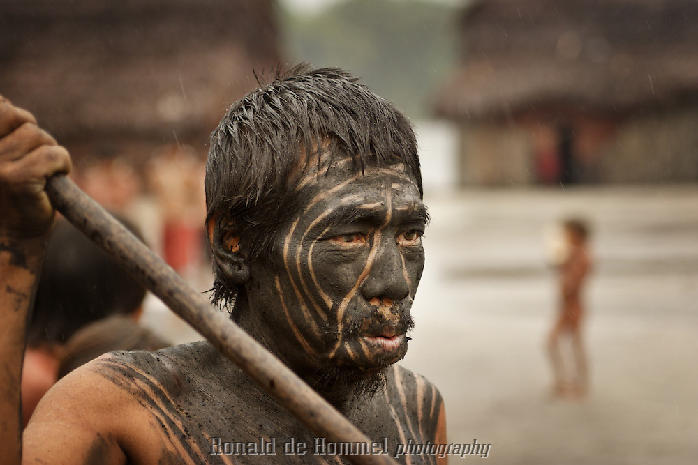 Viriunaveteri, Venezuela. Yanomami men dancing a tribal dance..The village of Viriunaveteri consists of 15 huts around a muddy square. It's situated in the Venezuelan Amazone several days by boat from the nearest town. This community on the banks of the Casiquiare is one of the few Yanomami villages that actually has some contact with the outside world. Most other tribes live deeper in the jungle.