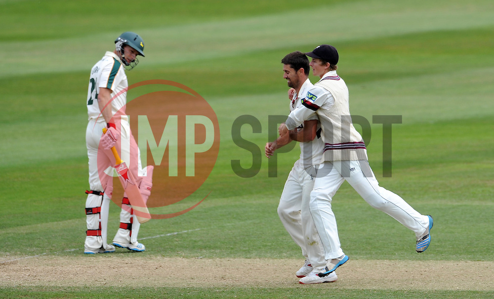 Somerset's Tim Groenewald and Tom Abell celebrate the wicket of Nottinghamshire's Will Gidman. - Photo mandatory by-line: Harry Trump/JMP - Mobile: 07966 386802 - 16/06/15 - SPORT - CRICKET - LVCC County Championship - Division One - Day Three - Somerset v Nottinghamshire - The County Ground, Taunton, England.