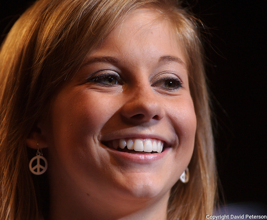 """Olympian Shawn Johnson flashes her mega-watt smile as she returned to her hometown of Des Moines, Iowa, Tuesday, August 26, after being on the road for over a month.  Johnson's homecoming was attended by over 7,000 fans who filled the Wells Fargo Arena in Des Moines.  Johnson showed off her four Olympic medals, including a gold for the balance beam.  The city of Des Moines declared the month of September """"Shawn Johnson Month"""".  As one of the most recognizable faces of the Beijing Olympics, Johnson has been on a whirlwind post Olympics tour, which has included an appearance on The David Letterman Show.  She will also appear on Jay Leno, and will lead the Pledge of Allegiance at this year's Democratic Convention."""