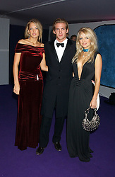 Left to right, EMILY CROMPTON, JACOBI ANSTRUTHER-GOUGH-CALTHORPE and HANNAH SANDLING at The British Red Cross London Ball - H2O The Element of Life, held at The Room by The River, 99 Upper Ground, London SE1 on 17th November 2005.<br />