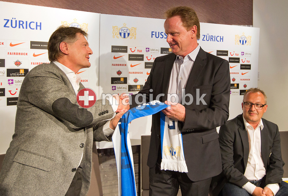 (L-R) FC Zuerich (FCZ) president Ancillo Canepa hands over a FCZ scarf to Rolf FRINGER after presenting him as new head coach of Swiss National League A soccer club FC Zuerich, while sporting director Fredy Bickel looks on, at the club's museum in Zurich, Switzerland, Friday, March 30, 2012. (Photo by Patrick B. Kraemer / MAGICPBK)