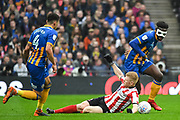 Aristote Nsiala of Shrewsbury Town (22) and Elliot Whitehouse of Lincoln City (4) battle for the ball during the EFL Trophy Final match between Lincoln City and Shrewsbury Town at Wembley Stadium, London, England on 8 April 2018. Picture by Stephen Wright.