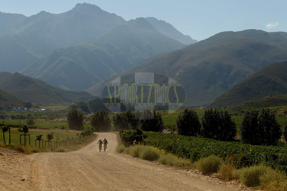 Riders take in the scenery during stage 1 of the 2012 Absa Cape Epic Mountain Bike stage race held from Robertson Primary School in Robertson, South Africa on the 26 March 2012..Photo by Greg Beadle/Cape Epic/SPORTZPICS