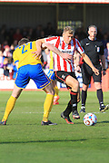 Danny Wright and Jamie McCombe  during the Vanarama National League match between Cheltenham Town and Lincoln City at Whaddon Road, Cheltenham, England on 30 April 2016. Photo by Antony Thompson.