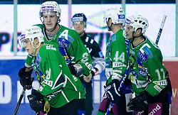 Eric Pance,  Bostjan Groznik and Jurij Golicic of Olimpija during 52nd Round of EBEL league ice-hockey match between HDD Tilia Olimpija, Ljubljana and EV Vienna Capitals, on February 7, 2010 in Arena Tivoli, Ljubljana, Slovenia. Vienna defeated Olimpija 8-2. (Photo by Vid Ponikvar / Sportida)