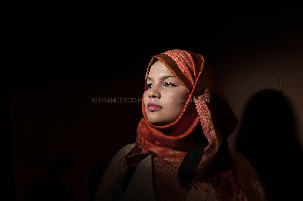 """Dicember 6, 2011. Egypt. Cairo. Samira Ibrahim, 25 years old, egyptian. .She is taking the Egyptian army to court for subjecting her to torture and abuse, including to a so-called """"virginity test,"""" while in military detention back in March. .Samira, along with 16 other women, were detained during a demonstration on March 9th. She was held for four days. During that time, she says soldiers beat her repeatedly. They subjected her to electric shocks. They screamed at her and threatened her. Then, worst of all, they made her strip so that a man in military clothes could check to see if she was a virgin. She felt like she had been raped. she is also pursuing a case in civil court, with the help of several human rights groups. They are asking judges to rule on the legality of Ibrahim's treatment by the military."""