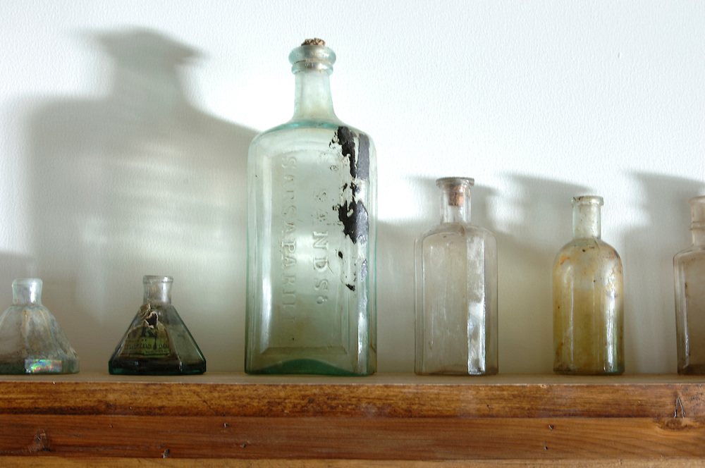 Light and shadow play with antique bottles