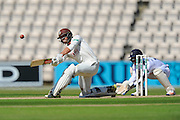 Surrey's Ben Foakes hits a six during the Specsavers County Champ Div 1 match between Hampshire County Cricket Club and Surrey County Cricket Club at the Ageas Bowl, Southampton, United Kingdom on 18 July 2016. Photo by Graham Hunt.
