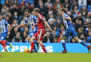 Middlesbrough FC midfielder Grant Leadbitter and Brighton defender, full back, Inigo Calderon (14) during the Sky Bet Championship match between Brighton and Hove Albion and Middlesbrough at the American Express Community Stadium, Brighton and Hove, England on 19 December 2015.