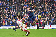 Milton Keynes Dons defender Callum Brittain (25) tackles a leaping Portsmouth defender Nathan Thompson (20) during the EFL Sky Bet League 1 match between Milton Keynes Dons and Portsmouth at stadium:mk, Milton Keynes, England on 10 February 2018. Picture by Dennis Goodwin.