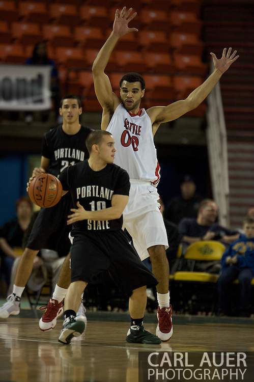 November 29th, 2008:  Anchorage, Alaska - Portland State guard Jeremiah Dominguez (10) backs into Seattle University forward Mike Boxley in the third place matchup between Portland State and Seattle University on the final day of the Great Alaska Shootout.