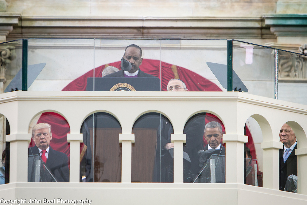 Newly sworn-in President Trump, President Obama and Vice President Biden bow their heads as Bishop Wayne T. Jackson delivers the final benediction following Donald Trump's inaugural address as the 45th President of the United States, on January 20, 2017.  John Boal Photography