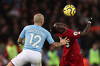 Football - 2019 / 2020 Premier League - Liverpool vs. Manchester City<br /> <br /> Angelino of Manchester City and Sadio Mane of Liverpool, at Anfield.<br /> <br /> COLORSPORT/PAUL GREENWOOD