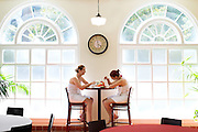 HOT SPRINGS, AR – JUNE 28, 2013: Young women laugh over lunch at the Quapaw Baths spa on historic Bathhouse Row.