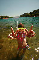 ten year old snorkeling on Hvar Island, Croatia-- photograph by Owen Franken