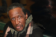 December 21, 2013-New York, NY-At a homeless persons' memorial service in Harlem, Genghis Khalid Mohammed, 65, paid his respects to others who died outside. &ldquo;You have more dignity in the street than in the shelter,&rdquo; he said, citing curfews, fights, and disrespect from staff. <br />  12/21/2013-Photo by Rosa Goldensohn/NYCity Photo Wire