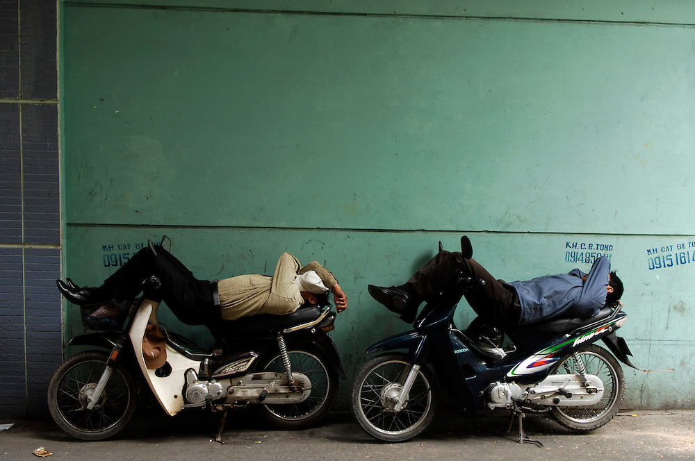 Hanoi:Motorcyclists take a nap