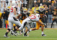September 25 2010: Iowa Hawkeyes returner Colin Sandeman (22) tries to hold off Ball State Cardinals linebacker Tony Martin (47) during the first half of the NCAA football game between the Ball State Cardinals and the Iowa Hawkeyes at Kinnick Stadium in Iowa City, Iowa on Saturday September 25, 2010. Iowa defeated Ball State 45-0.