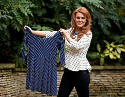 © Licensed to London News Pictures. 25/01/2013. London, UK. Liz Evans (27), Slimming World's Miss Slinky 2013, is seen with one of the dresses she wore before losing 8 stone in the garden of the Ritz Hotel in London today (25/01/13). Liz, formerly a size 18, lost 5 stone in less than eight months to become a size 8 in preparation for her wedding day. Photo credit: Matt Cetti-Roberts/LNP
