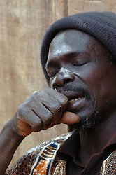 BURKINA FASO, Bani, 2007. Eyes closed in concentration, a man participates in the devotional singing of the town's Muslims.