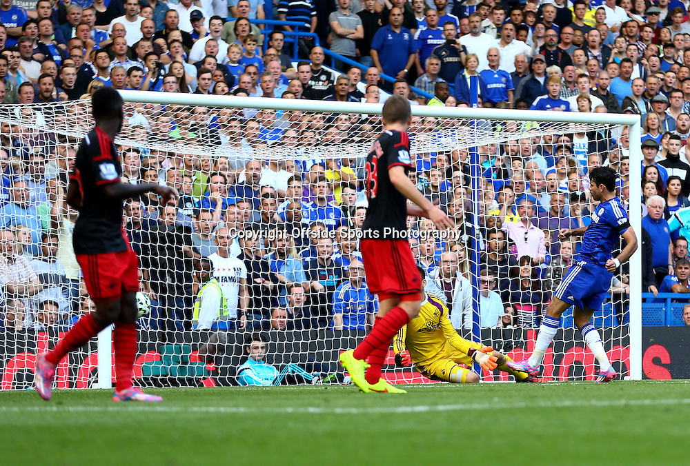 13 September 2014 - Barclays Premier League - Chelsea v Swansea City - Diego Costa of Chelsea scores his hat-trick goal - Photo: Marc Atkins / Offside.