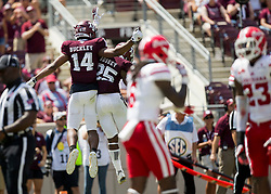 Texas A&M wide receiver Camron Buckley (14) and running back Kendall Bussey (25) react after a touchdown of an NCAA college football game Saturday, Sept. 16, 2017, in College Station, Texas. (AP Photo/Sam Craft)
