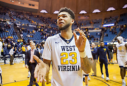 Nov 20, 2016; Morgantown, WV, USA; West Virginia Mountaineers forward Esa Ahmad (23) celebrates after beating the New Hampshire Wildcats at WVU Coliseum. Mandatory Credit: Ben Queen-USA TODAY Sports