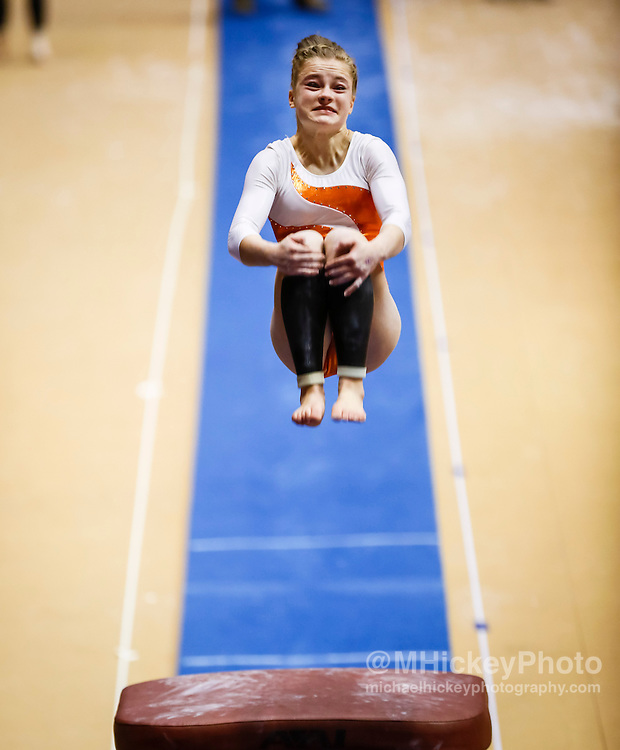 Columbus East sophomore  Emily Clancy performs during the vault exercise where she finished third during the IHSAA gymnastics state finals meet at Worthen Arena in Muncie, Indiana. (Michael Hickey | For The Republic)