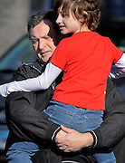 A man carries a child away from the area of a shooting at the Sandy Hook Elementary School in Newtown, Conn., Friday, Dec. 14, 2012. (AP Photo/Jessica Hill)