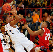 5 MARCH 2011 -- NORMANDY, Mo --  McCluer North High School basketball player BJ Young (1) launches a shot against defensive pressure from Chaminade College Prep's Bradley Beal (23) during the MSHSAA Class 5 boys basketball quarterfinals at Mark Twain Hall on the University of Missouri - St. Louis campus in Normandy, Mo. Saturday, March 5, 2011. The Stars upset the Red Devils 57-56 to advance to MSHSAA semifinals. Image © copyright 2011 Sid Hastings.