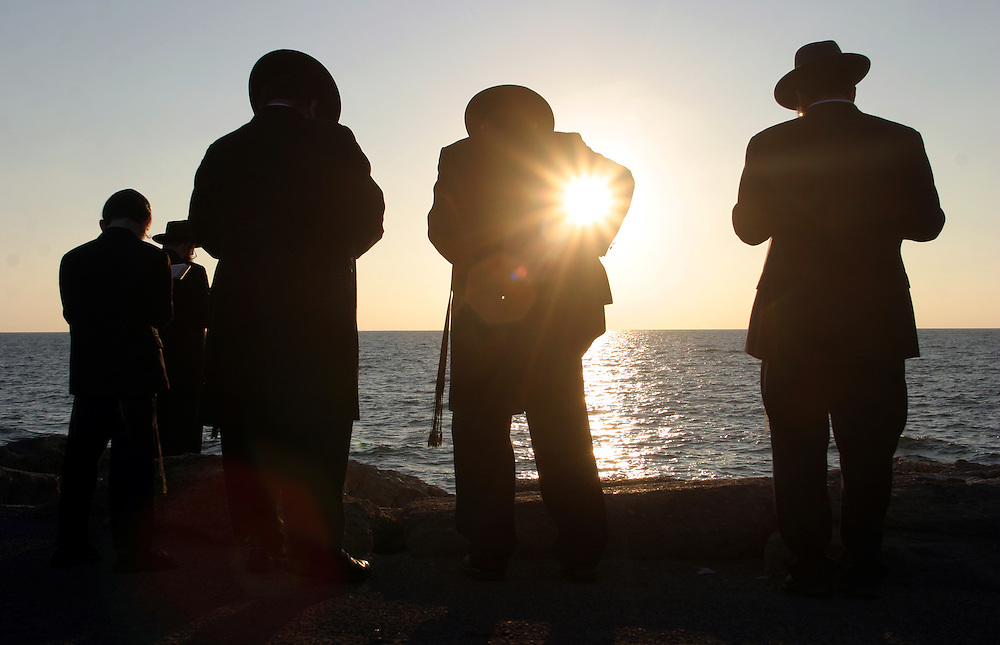 A group of Jewish men and woman pray and empty their pockets during the Jewish New Year ritual of Tashlich at a beach in Tel ?Aviv September 25, 2006. Worshippers empty their pockets into the Mediterranean sea in a symbolic cleansing of their sins ahead of the New Year. Sometime between Rosh Hashana, the Jewish New Year, and Yom Kippur, The Jewish high holy day of Yom Kippur, or the Day of AtonementThe day is a 25-hour long period of fast and prayers and Jews have to repent for their sins of the past year before God.