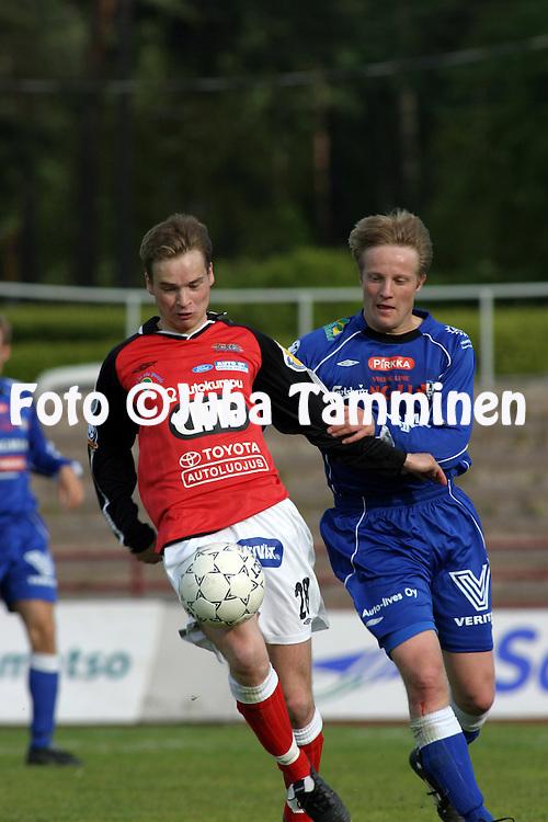01.06.2003, Pori, Finland..Veikkausliiga 2003 / Finnish League 2003.FC Jazz v FC H?meenlinna.Jani Raukko (FC Jazz) v Jukka Vanninen (Hml).©Juha Tamminen