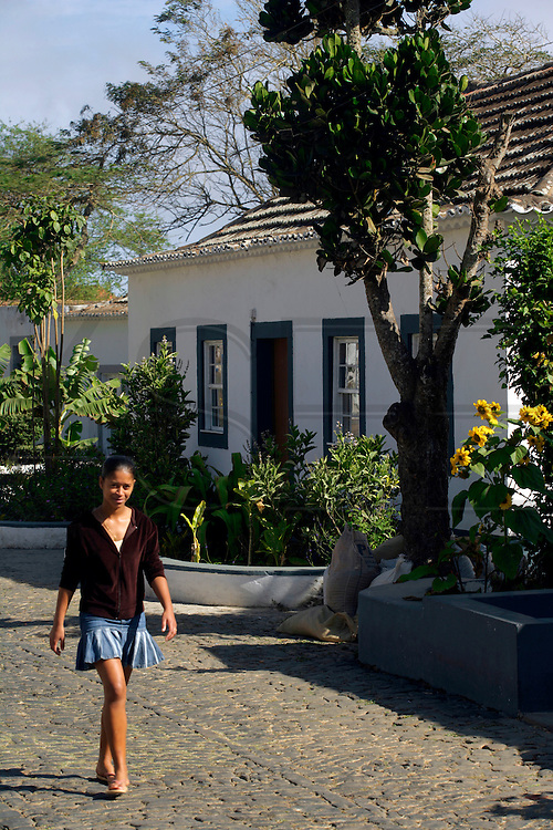 A girl walks on a street in Nova Sintra, Brava island capital village. This village is a gem of simple colonial architecture featuring humble houses in a plateau about 600 metres from sea level.