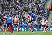 Leicester City defender Christian Fuchs (28)  with a header during the Barclays Premier League match between Leicester City and Southampton at the King Power Stadium, Leicester, England on 3 April 2016. Photo by Simon Davies.