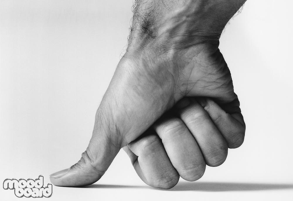 Thumb pressing down (b&w) (close-up)