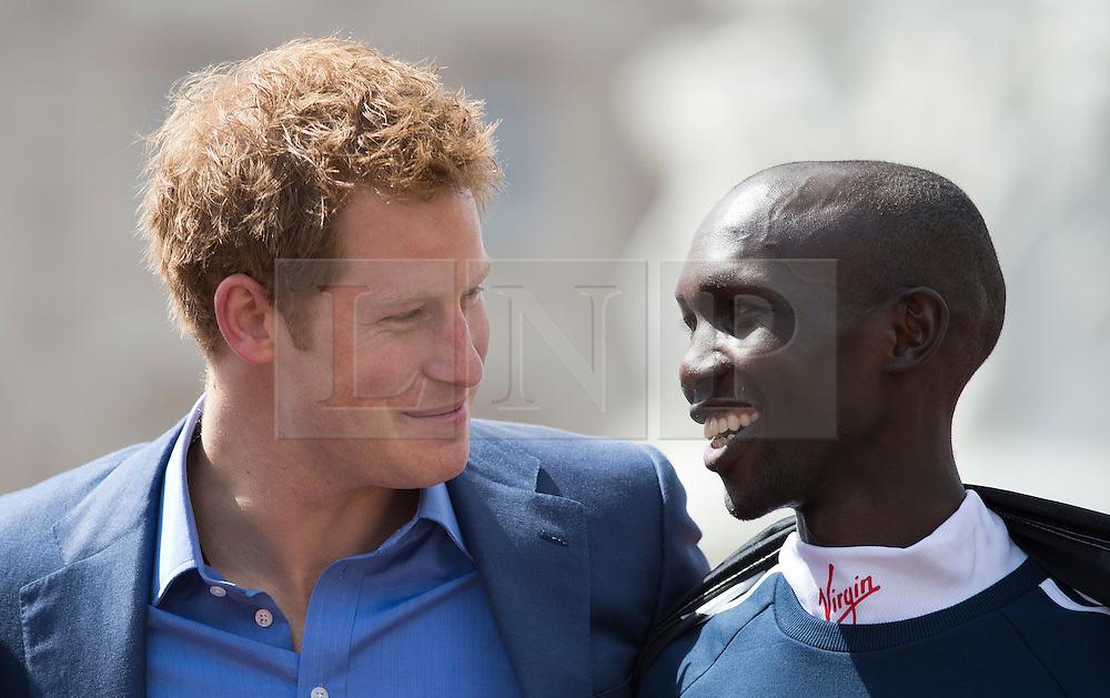 © London News Pictures. 22/04/2012. London, UK. HRH Prince Harry face to face with Wilson Kipsang of Kenya after presenting Kipsang with his trophy for winning the men's elite race at the 2012 Virgin London Marathon on April 22, 2012. Photo credit : Ben Cawthra /LNP