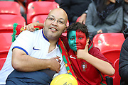 Man and boy supporting Portugal during the Friendly International match between England and Portugal at Wembley Stadium, London, England on 2 June 2016. Photo by Matthew Redman.