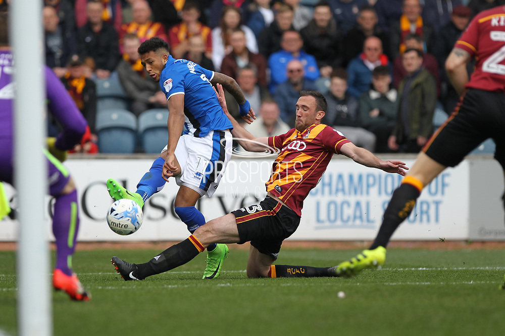 Nathaniel Mendez-Laing shoots challenged by Rory McArdle during the EFL Sky Bet League 1 match between Rochdale and Bradford City at Spotland, Rochdale, England on 30 April 2017. Photo by Daniel Youngs.